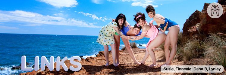 Four girls bend over by the sea, flashing panties.